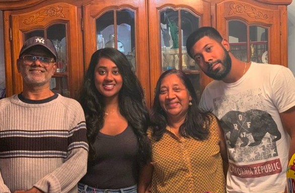 Photo of Latchmi and her family in her fmaily home.